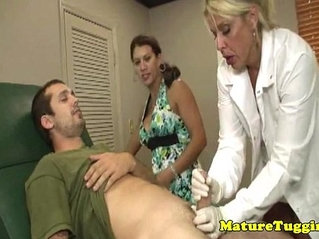 Busty milf dr tugs cock in kinky ffm action