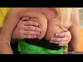 Blonde granny in stockings rides cock