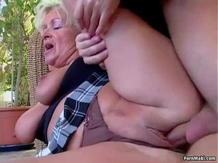 Big titted mom takes cock