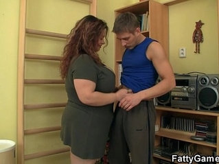 Fatty seduces him and fucks in the gym